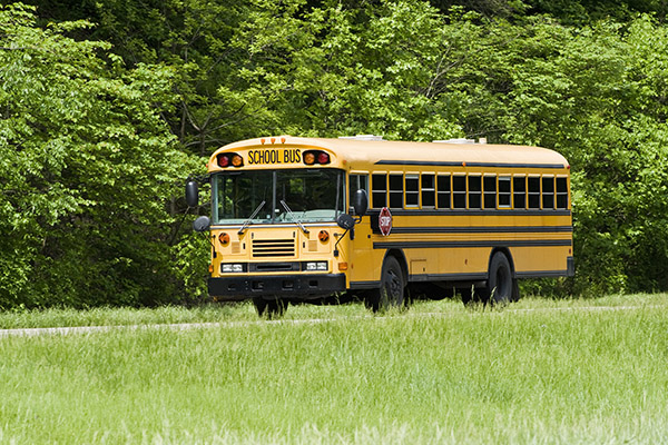 School Bus Traveling On Interstate in Springtime